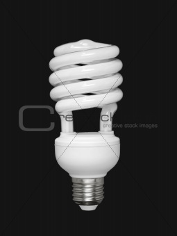 Fluorescent light bulb over black