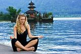Girl meditating at the lake on Bali