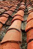Aged old red clay arabic roof tiles