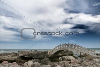 bridge on the rockland near the sea