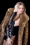Young woman in latex suit and a fur coat