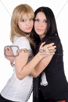 Portrait of the two embracing girlfriends. Isolated on white