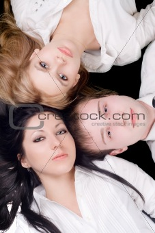 Portrait if the young man and two beautiful women