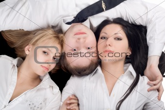 Portrait if the young man and two beautiful girls