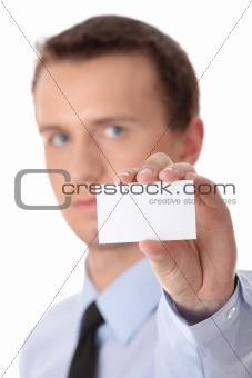 Businessman holding blank card