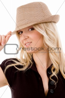 portrait of smiling female holding hat