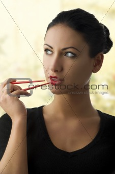 charming woman with chopstick
