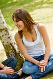 casual woman smiling outdoors