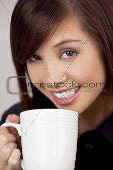 Beautiful Asian Woman Drinking Coffee or Tea