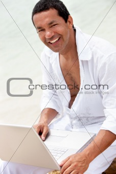 beach man with computer
