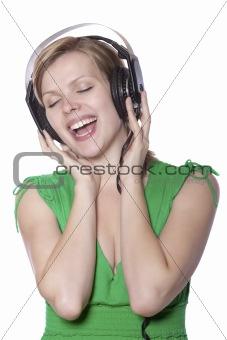 beautiful girl singing to music