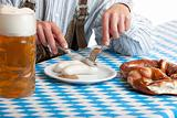 Bavarian man having lunch at Oktoberfest