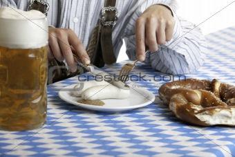 Bavarian man having lunch at Oktoberfest