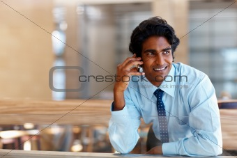 Young business man talking on a mobile phone
