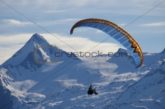 winter paragliding in alps mountain