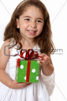 Angelic girl holding a gift