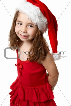 Smiling girl in red santa hat
