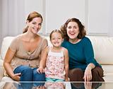 Three generation family sitting on sofa