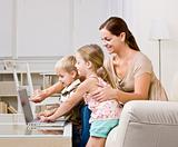 Mother showing children laptop