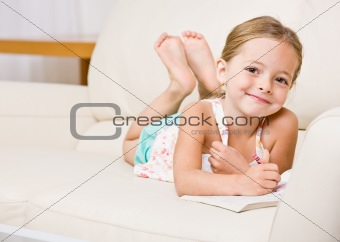 Girl coloring in coloring book