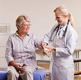 Doctor adjusting senior womanÕs wrist splint