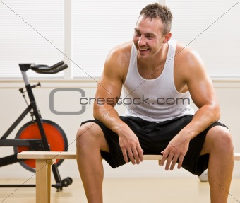 Man resting in health club