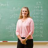 Teacher standing near blackboard