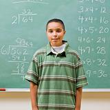 Student standing near blackboard