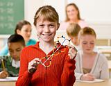 Student holding helix in classroom