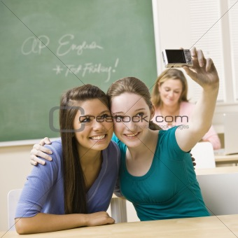 Students taking self-portrait in classroom