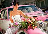 Bride on pink limousine