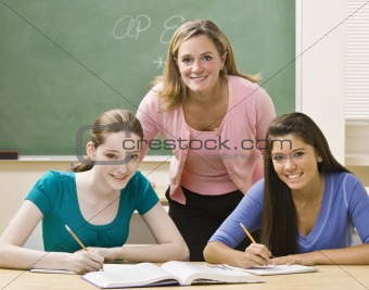 Teacher helping students study