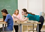 Student tapping classmate in classroom