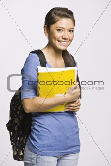 Student carrying backpack and notebook