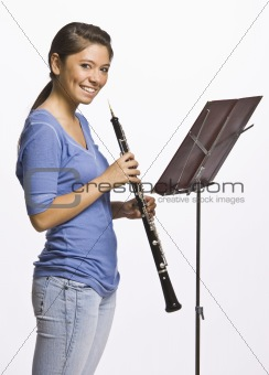 Teenage girl playing clarinet