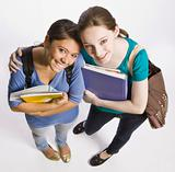 Students carrying book bag, backpack and notebooks