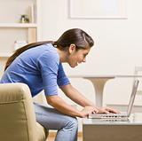 Teenage girl using laptop
