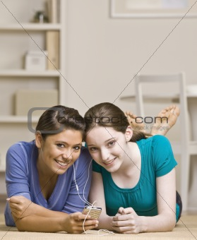 Teenage girls sharing mp3 player