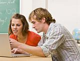 Students studying together in classroom