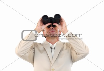Mature businessman holding binoculars upwards