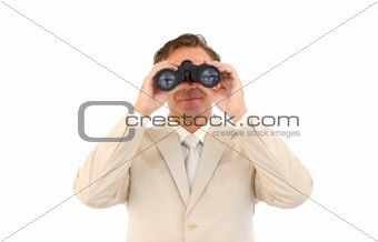 Serious businessman using binoculars