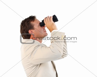 Attractive businessman holding binoculars