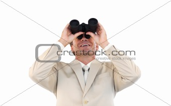Caucasian businessman holding binoculars in front of the camera