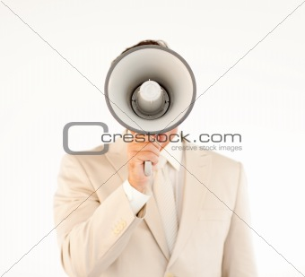 Caucasian businessman using a megaphone