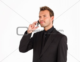 Attractive serious businessman talking on phone