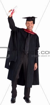 Smiling boy showing his diploma to the camera