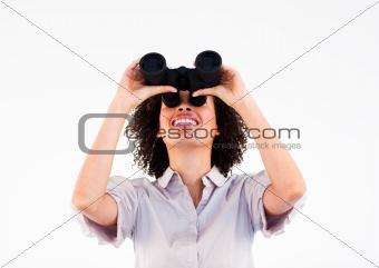 Portrait of ethnic businesswoman holding binoculars upwards