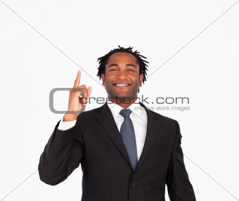 Afro-american businessman pointing upwards
