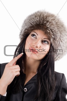 Portrait of the young woman in a fur cap. Isolated on white back