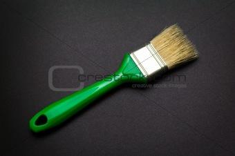 paintbrush at black paper background